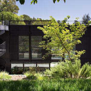 Orinda addition facade and spiral staircase