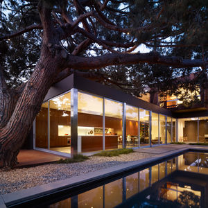 Finally, the stone pine tree reveals itself from the backyard looking over the Venice neighborhood. Its canopy stretches over the first floor of the home and can be glimpsed by the skylights placed strategically above the living area.