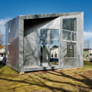 sustainable house facade with fiber cement and aluminum panels