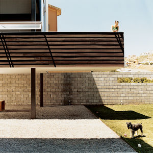 In August of 2004, a weekend-long party took place at a new house in the Hacienda Agua Caliente neighborhood of Tijuana, Mexico. The house was raw and unfinished, with bare concrete floors and exposed nail heads, but the art that adorned the walls and the