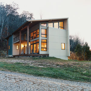 The Weber house overlooks a tranquil valley of farms in Black Earth, Wisconsin. The rear of the house—modern and right-angled—both contrasts and complements the surrounding vernacular architecture.