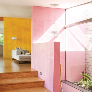 Modern home interior with pink and yellow walls