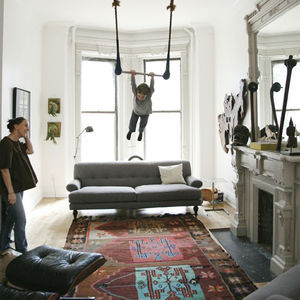 modern living room design with kilim rug and eames lounge chair