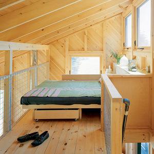 White pine clad bedroom