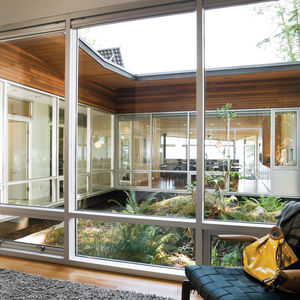 Modern wood-and-glass central atrium