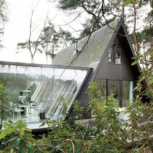 Modern glass extension in Belgium.