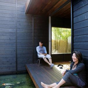 Charred cedar siding koi pond modern porch