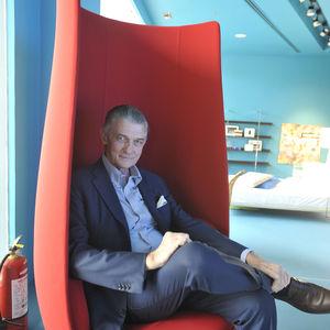 portrait of giulio cappellini in marcel wanders tulip chair