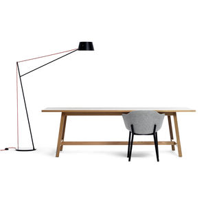 black floor lamp, chair, and wood table by new zealand company resident