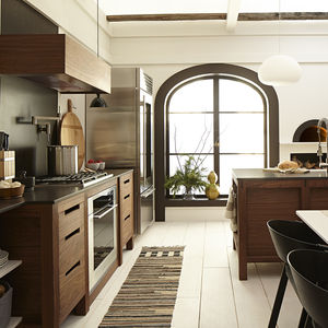 modern scandinavian-inspired kitchen with wood cabinets