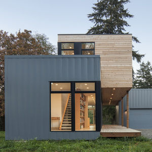 modern cedar-clad prefab house by method homes