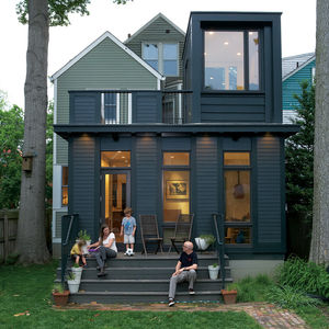 black facade of an addition to a Victorian home