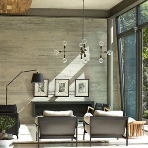 Modern living room with a concrete wall in Mexico City