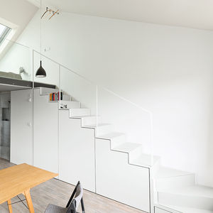 White staircase with under stair storage