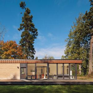 slender in grass prefab facade corten steel cedar  0