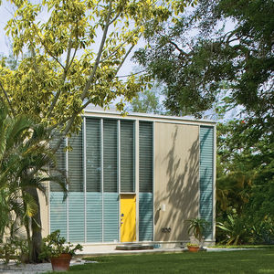 Boxy Umbrella house with yellow door