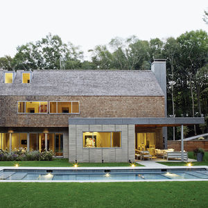 Hamptons house with a pool and cedar siding