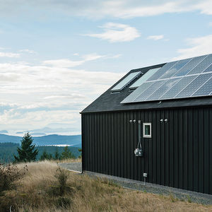 Environmentally friendly Orcas Island home exterior with solar panels