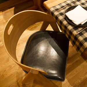 roman williams upland restaurant interior design leather chair