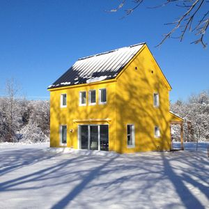 yellow maine passive house