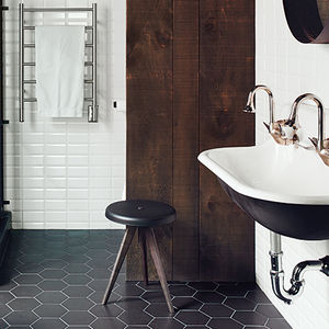 hitting the plateau master bath black white tile