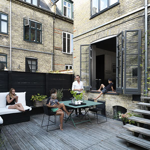 monochromatic copenhagen townhouse deck patio