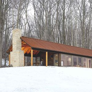 off the grid retreat exterior snow