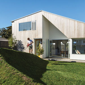 a matter of truss new zealand facade yard cedar cladding grassy berm portrait