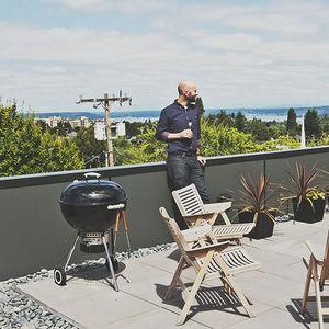 capitol gains seattle multifamily roof deck portrait rocker chairs steel planters