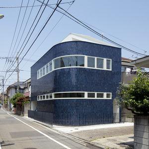half half house blue tile exterior
