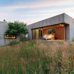 a movable feat marthas vineyard prefab modular concrete boxes facade wood paneling