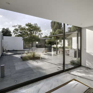 Granite and marble floors of weekend home by Asociacion de Diseno in Mexico.