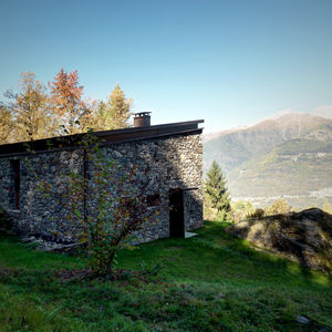 Italian Apline home clad in local stone.