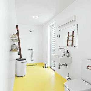 Modern bathroom with yellow floors