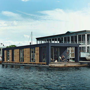come home to high water copehagen floating home facade terrace