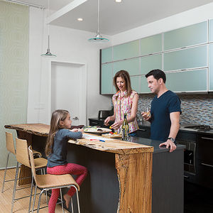 family matters david alan basche alysia reiner harlem renovation kitchen reclaimed maple countertop blu dot barstools