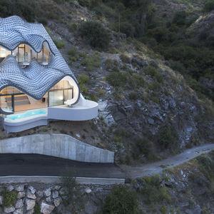 Spanish home embedded in hillside.