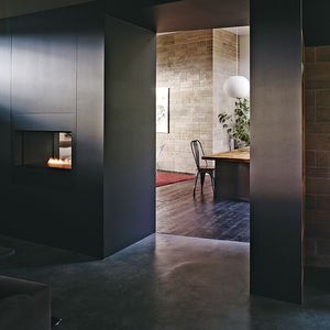 greener building block rammed earth brick gas fireplace dining area