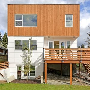 Eco-friendly prefab by Greenfab with cedar and James Hardie panel facade.