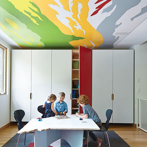 Kansas City kids' playroom with mural on the ceiling