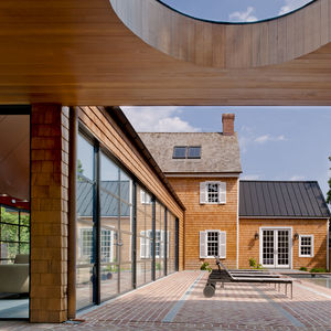 Steel swing doors in patio of Delaware renovation by Robert M. Gurney Architect