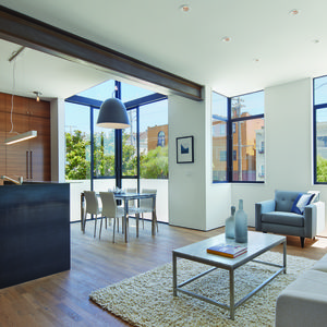 Living room with oak floors and CB2 Capitol Pendant Light in San Francisco renovation and addition by Zack   de Vito Architecture + Construction.
