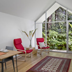 Red POÄNG chairs from IKEA in Berkeley cottage by Turnbull Griffin Haesloop.