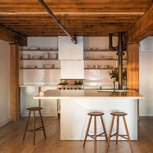 new york accent manhattan loft renovation kitchen zinc cabinets quartzite countertops fir beams saw kille counter stools white oak lv wood flooring viking range