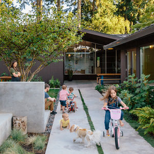 northwest bound portland family dream home concrete walled courtyard benjamin moore paint facade