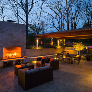 Outdoor living area with a fireplace at a renovated Pennsylvania Colonial