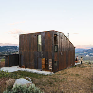 sailing the high desert prefab vaction home narrow building storage outdoor kitchen facade