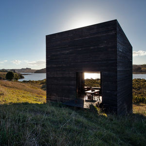 sea change new zealand cabins facade replanted site structures