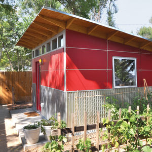 A backyard shed, clad in Collins Truwood siding and corrugated metal, doubles as an office.