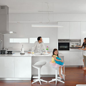 Spiral House kitchen with Teka oven, hood, and cooktop.